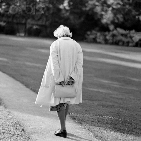 Elderly woman walking on a path