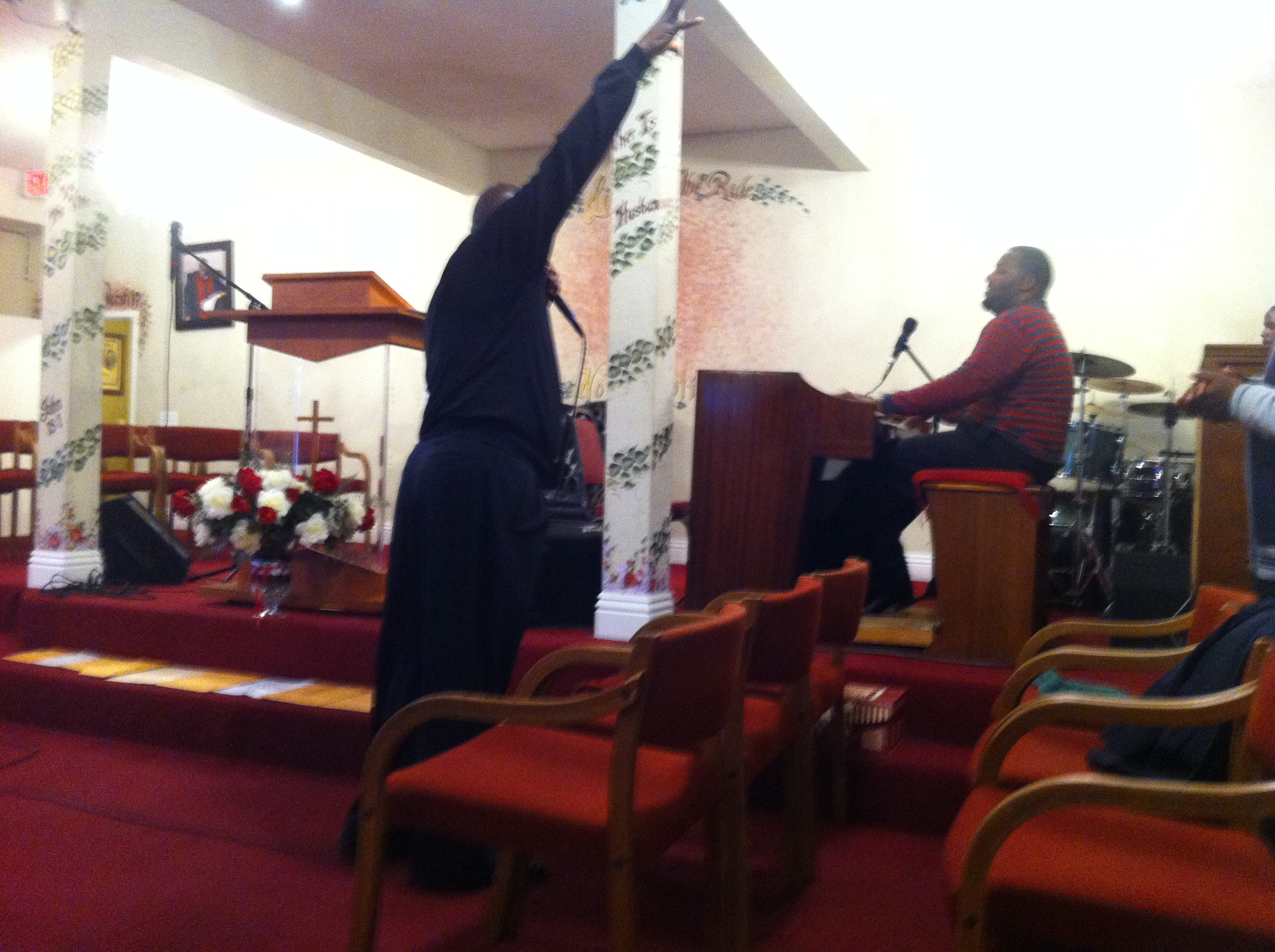 The pastor and organist playing off each other during the Praise and Worship part of the meeting.